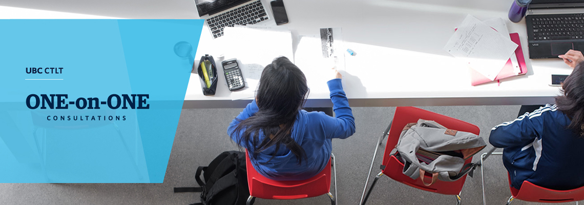 student sitting at white desk working while facing forward